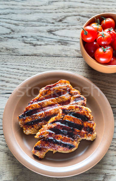 Grilled pork steaks on the plate Stock photo © Alex9500