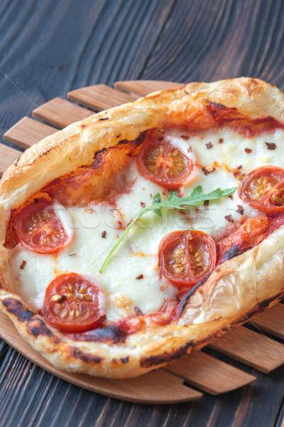 Stock photo: Mini pizza on the wooden board