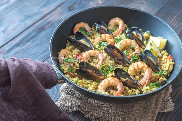 Seafood paella in the pan Stock photo © Alex9500