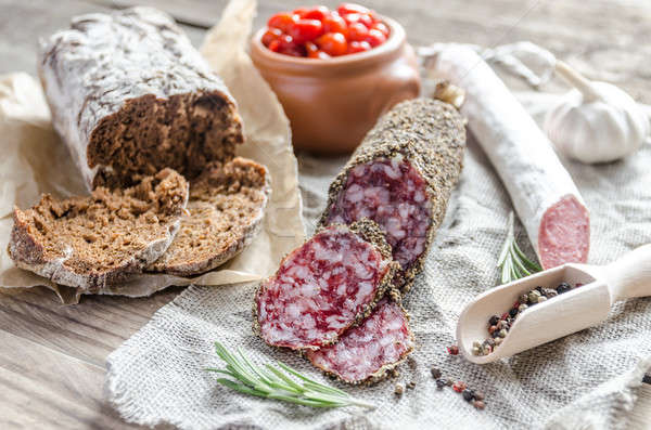 Slices of saucisson and spanish salami on the sackcloth Stock photo © Alex9500