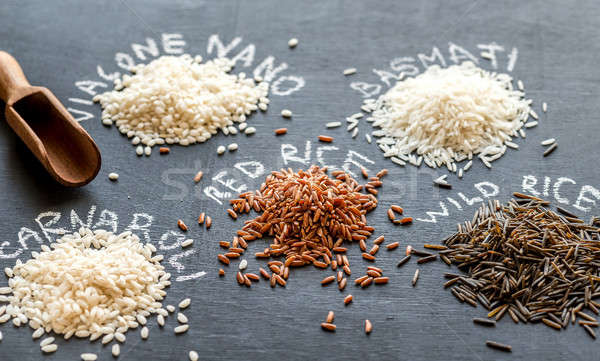 Different kinds of rice on the dark background Stock photo © Alex9500