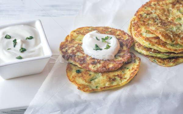 Portion of zucchini fritters with greek yogurt Stock photo © Alex9500