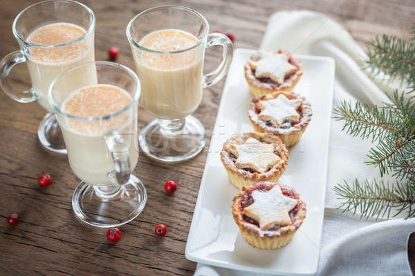 Glasses of eggnog with mince pies Stock photo © Alex9500