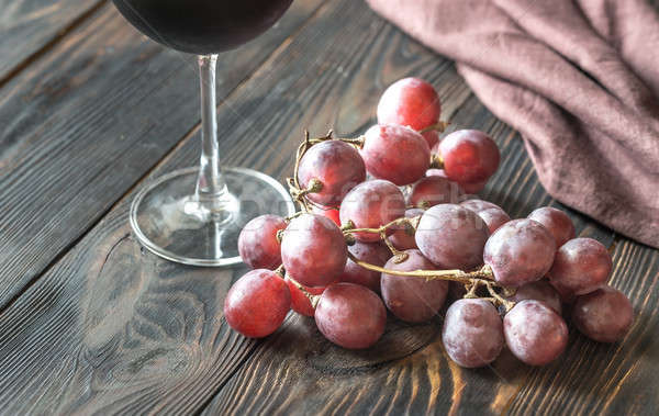 Glass of red wine with bunch of red grape Stock photo © Alex9500