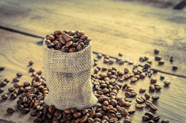 Stock photo: Coffee beans in the sackcloth bag