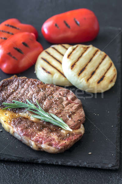 Grilled beef steak with bell peppers and cheese Stock photo © Alex9500
