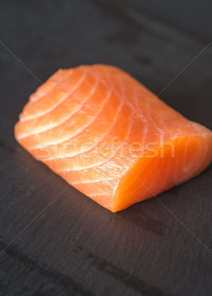 Salmon on the black stone board Stock photo © Alex9500