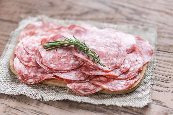 Slices of salami on the wooden board Stock photo © Alex9500