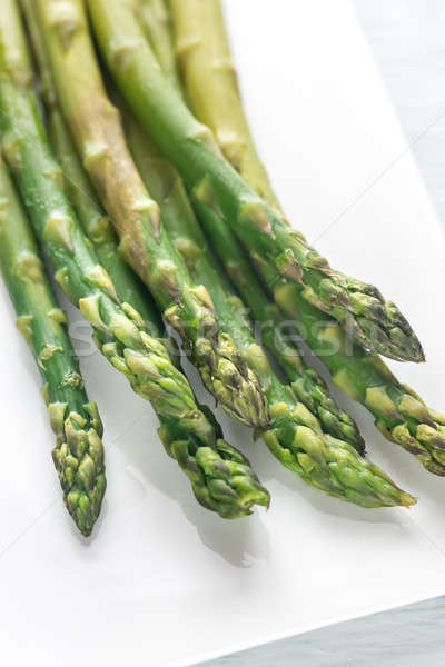 Bunch of cooked asparagus on the plate Stock photo © Alex9500