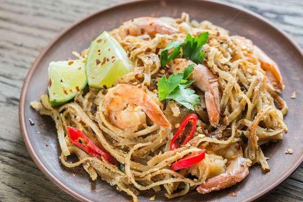 Thai fried rice noodles with shrimps Stock photo © Alex9500