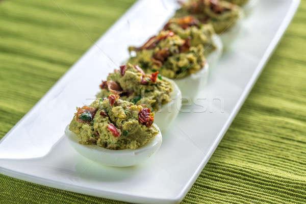 Bacon guacamole deviled eggs Stock photo © Alex9500
