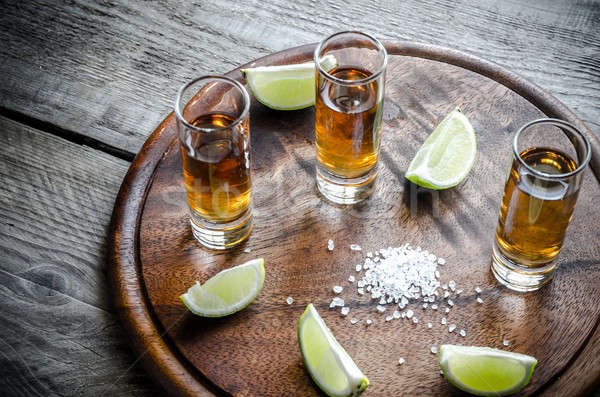 Verres tequila fruits table bar Photo stock © Alex9500