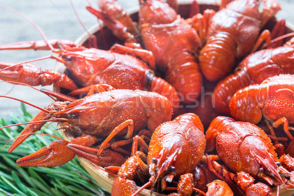 Bowl of boiled crayfish on the wooden table Stock photo © Alex9500