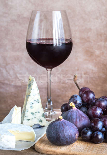 Red wine with cheese, figs and grapes Stock photo © Alex9500