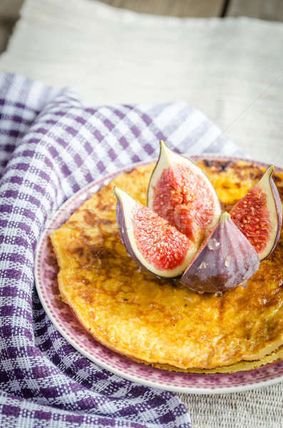 Pile of pumpkin crepes decorated with fresh fig Stock photo © Alex9500