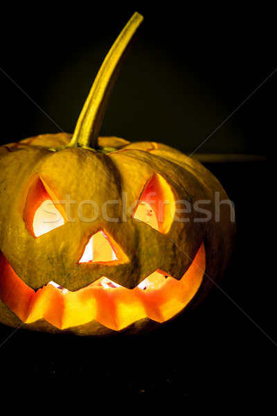 Glowing halloween pumpkin in candlelight Stock photo © Alex9500