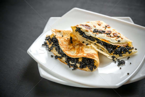 Crepes with black caviar Stock photo © Alex9500