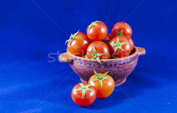 Cherry tomatoes in clay bowl Stock photo © Alex9500