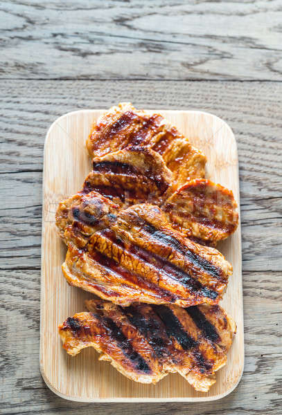 Grilled pork steaks on the wooden board Stock photo © Alex9500