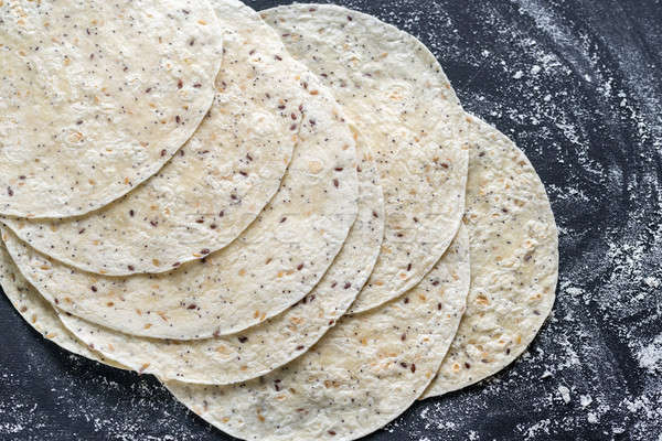 Stock photo: Stack of tortillas on a black surface