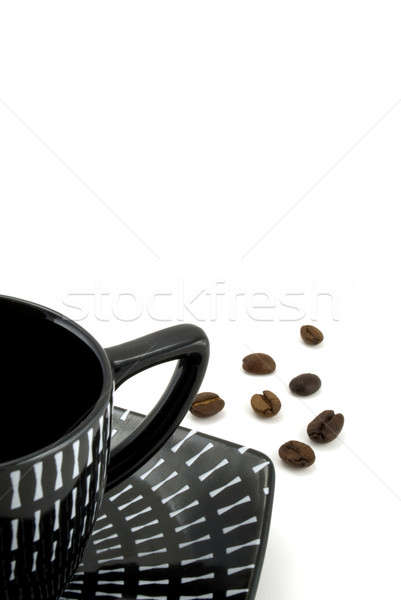 Black cup with coffee costing on a coffee grain Stock photo © alex_davydoff
