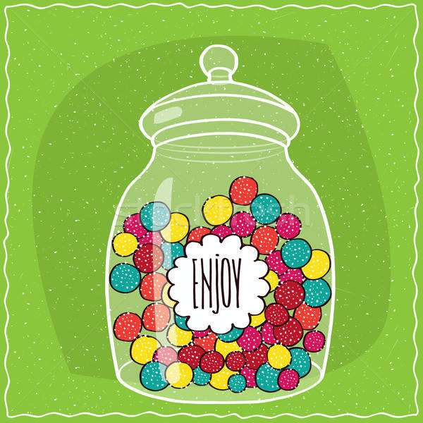 Glass jar with colorful round candies inside Stock photo © alexanderandariadna