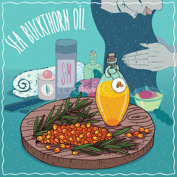 Sea buckthorn oil used for hair care Stock photo © alexanderandariadna