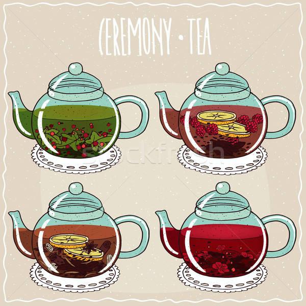 Set of different brewed flower and berry teas Stock photo © alexanderandariadna