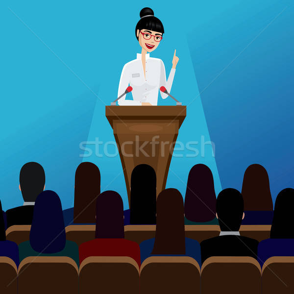 Business woman public speaker on conference Stock photo © alexanderandariadna