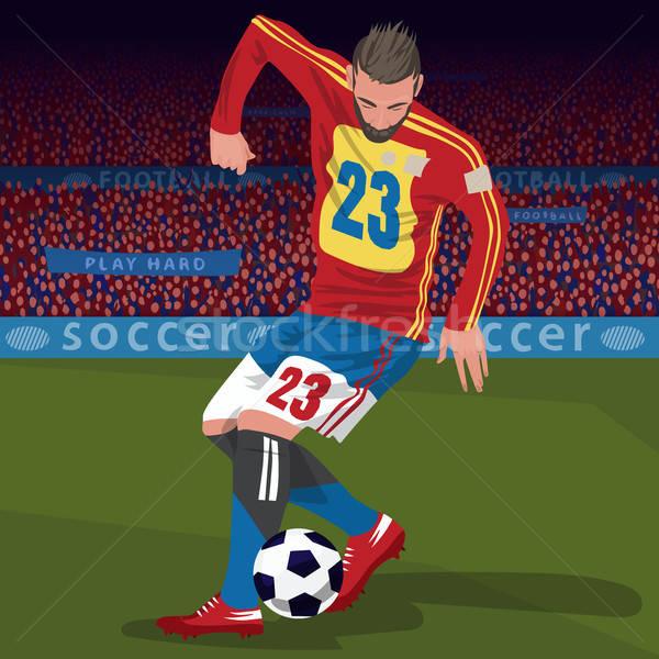 Football player with ball in stadium Stock photo © alexanderandariadna