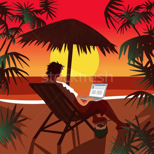 Man working on notebook on beach at sunset Stock photo © alexanderandariadna