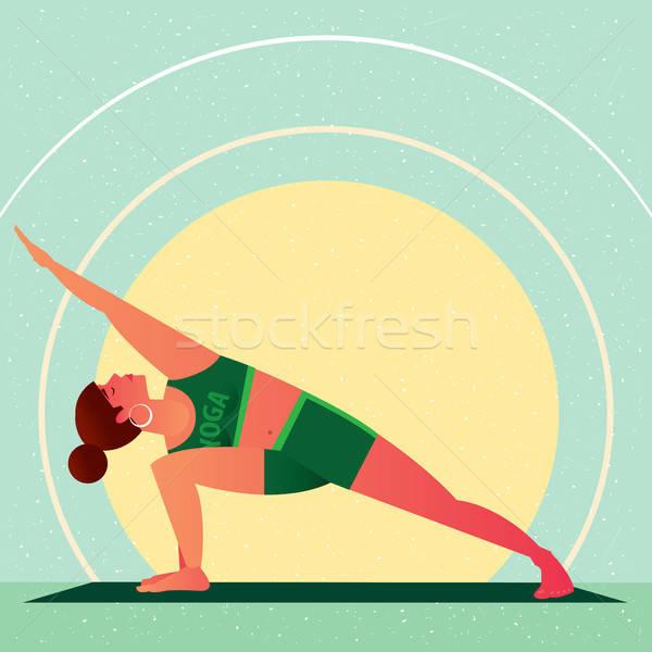 Girl standing in Yoga Extended Side Angle Pose Stock photo © alexanderandariadna