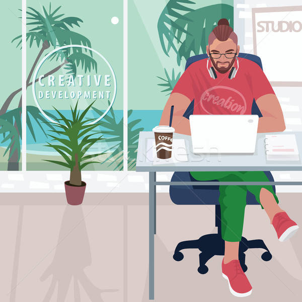 Hipster working in office with tropical landscape Stock photo © alexanderandariadna