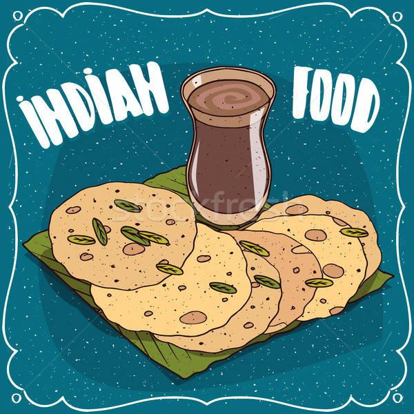 Indian round flatbread and masala chai tea Stock photo © alexanderandariadna