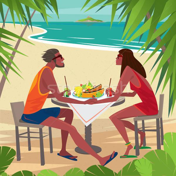 Coppia tavola mangiare colazione spiaggia Foto d'archivio © alexanderandariadna