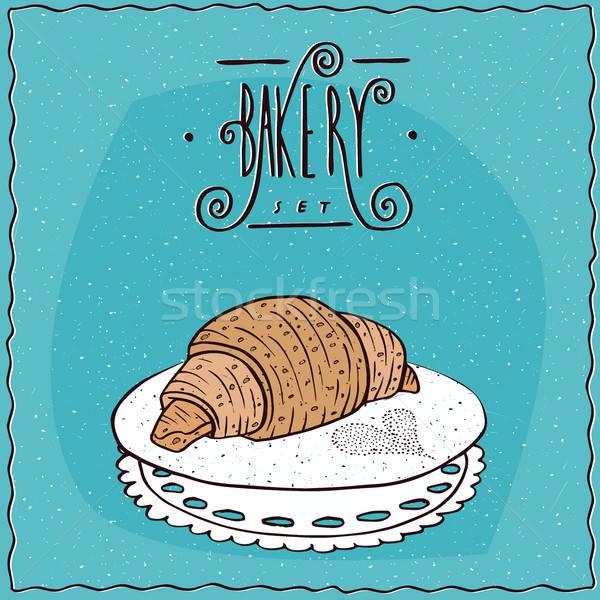 Perfect croissant lie on lacy napkin Stock photo © alexanderandariadna
