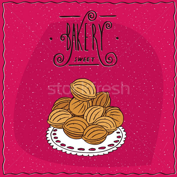 Cookies in the form of walnuts on a lacy napkin Stock photo © alexanderandariadna
