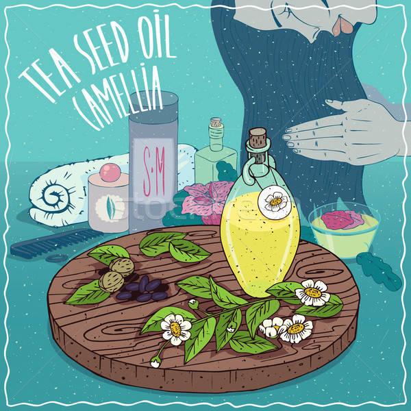 Chá semente Óleo usado cuidados com os cabelos vidro Foto stock © alexanderandariadna