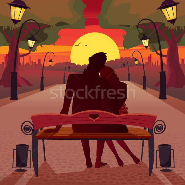 Amour parc couple séance banc coucher du soleil Photo stock © alexanderandariadna