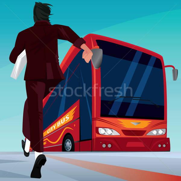Businessman in a hurry for the passenger bus Stock photo © alexanderandariadna