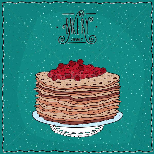 Thin pancakes with red berries on lacy napkin Stock photo © alexanderandariadna