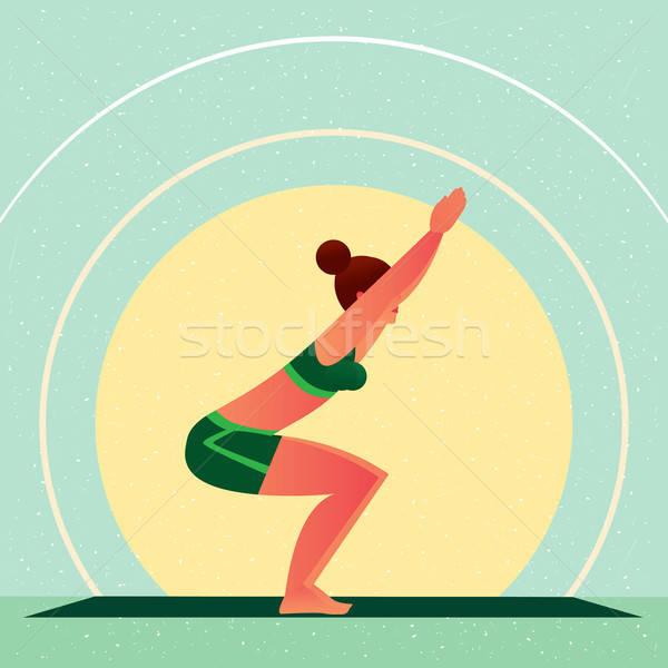 Girl standing in Yoga Chair Pose or Utkatasana Stock photo © alexanderandariadna