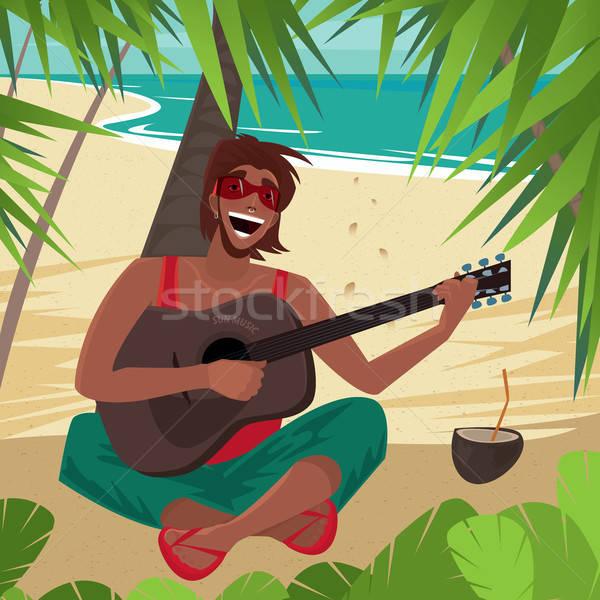Guy sitting on a beach, plays guitar and sings Stock photo © alexanderandariadna