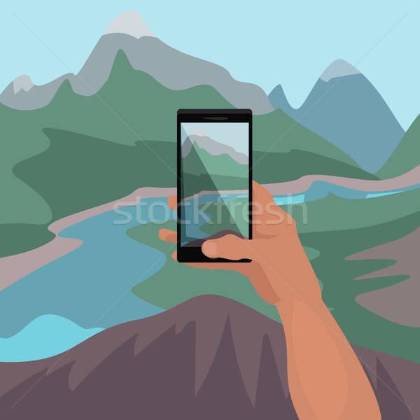 Stock photo: Hand making photo of landscape on smartphone