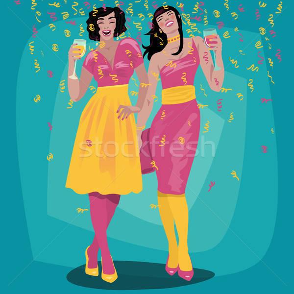 Couple of attractive girls raise their glasses Stock photo © alexanderandariadna