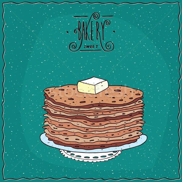 Thin pancakes with slice of butter on lacy napkin Stock photo © alexanderandariadna