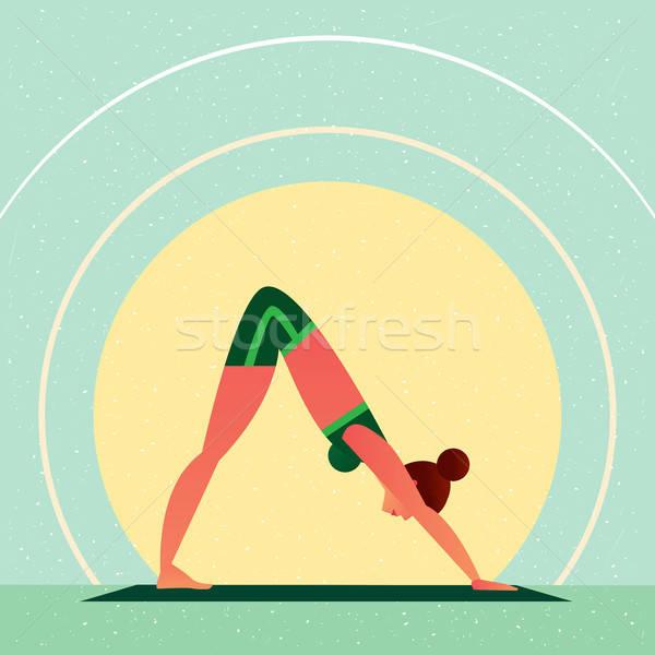 Girl in Yoga Downward-Facing Dog Pose Stock photo © alexanderandariadna