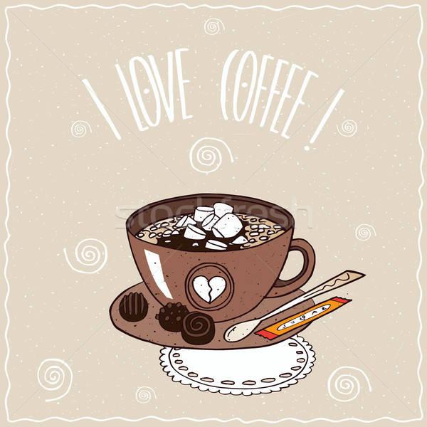 Cup of coffee with marshmallow on lacy napkin Stock photo © alexanderandariadna
