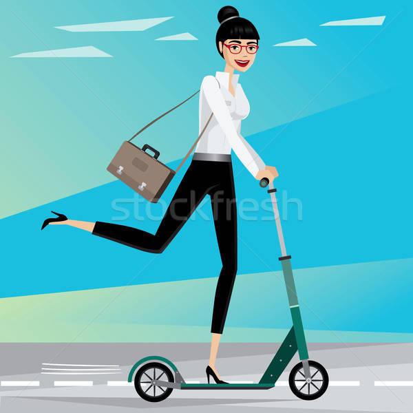 Business woman rides a scooter Stock photo © alexanderandariadna