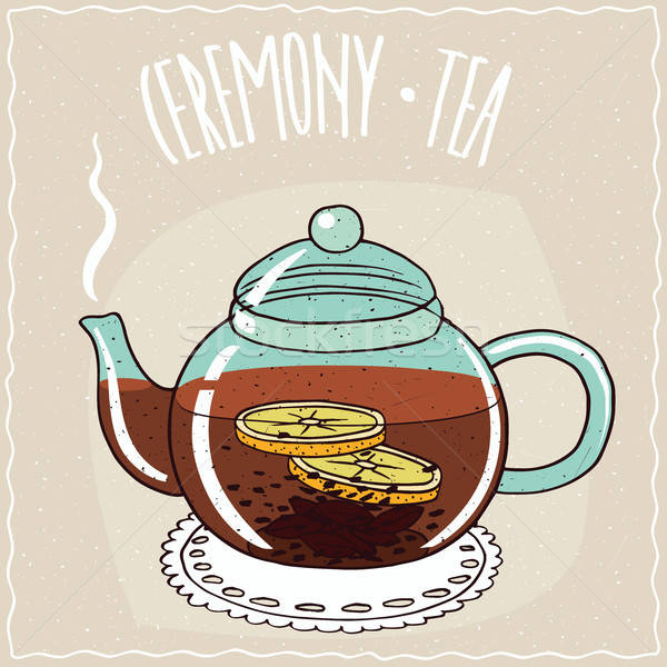 Glass teapot with black tea with lemon Stock photo © alexanderandariadna
